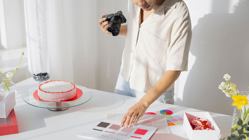 Woman selecting colour swatches